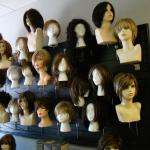 Wigs for sale located inside front door of Salon